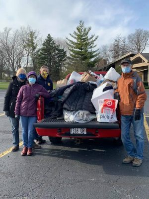 """Thanks for helping us fill the """"Little Red Truck"""" with winter wear for Hope Chicago and holiday gifts for the PRC's """"Share the Spirit"""" program!"""