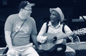 Jay enjoys sharing his gift of music with his Cuban friend!